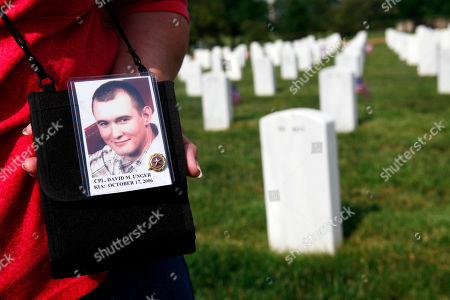 Stock Image of Katie Echols, of Leavenworth, Kan., holds a photo of her grandson, Army Corp. David Unger, 21, who died while serving in Iraq in 2006. Though Unger is buried in Kansas, Echols wanted to visit the graves in section 60 of Arlington National Cemetery, where many of the casualties from Iraq and Afghanistan are buried, in Arlington, Va., on
