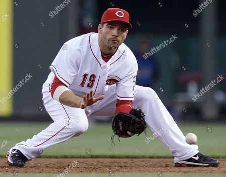 Joey Votto Cincinnati Reds first baseman Joey Votto fields a ball hit by New York Mets' Luis Castillo in the third inning of a baseball game, in Cincinnati. Castillo was out at first