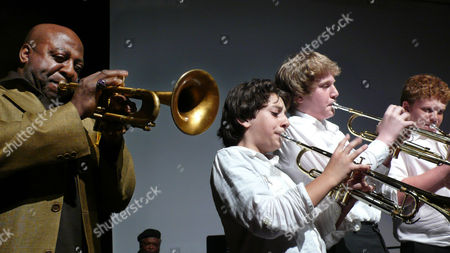 Stock Picture of Joey Morant, Michael Imperioli, Leo Gitelman, Matt Wilens Trumpeter Joey Morant, right, accompanies students Vadim Imperioli, 11, center, Leo Gitelman, center right and Matt Wilens, at the Claremont Preparatory School in New York, . Each week since January, Morant and other jazz artists have been working with students in the school's new jazz residency program. The program is partially organized by actor Michael Imperioli, Vadim's father