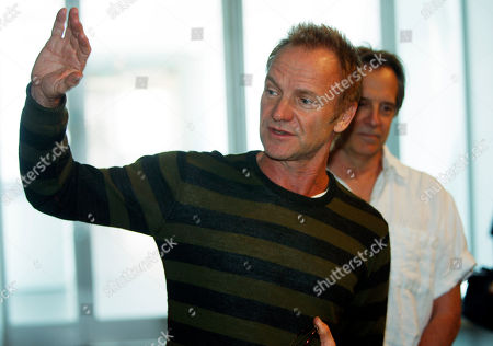 "Sting, Stephen Hannock Rock star and environmental activist Sting, front, joins painter Stephen Hannock in looking over Hannock's atmospheric Colorado landscape entitled ""Mount Blanca with Ute Creek at Dawn"" where the painting is displayed in the Denver Art Museum in Denver on . Sting, who is performing in Denver on Thursday, has known Hannock for more than 25 years"