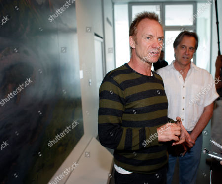 "Sting, Stephen Hannock Rock star and environmental activist Sting, front, talks to reporters after he and painter Stephen Hannock looked over Hannock's atmospheric Colorado landscape entitled ""Mount Blanca with Ute Creek at Dawn"" where the painting is displayed in the Denver Art Museum in Denver on . Sting, who is performing in Denver on Thursday, has known Hannock for more than 25 years"
