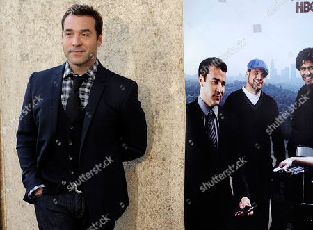 """Jeremy Piven Jeremy Piven, a cast member in """"Entourage,"""" poses alongside a poster showing his character Ari Gold at the premiere of the seventh season of the HBO series in Los Angeles"""