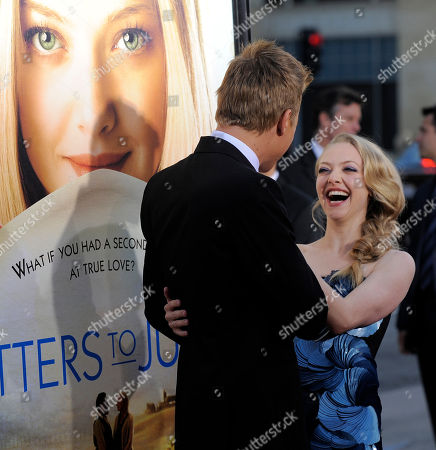 "Amanda Seyfried, Chris Egan Actress Amanda Seyfried, right, is greeted by her ""Letters to Juliet"" co-star Chris Egan at the premiere of the film in Los Angeles"