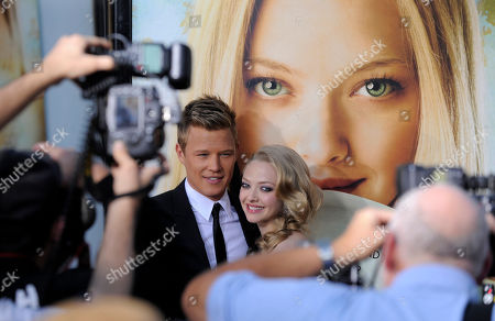 "Chris Egan, Amanda Seyfried Chris Egan, left, and Amanda Seyfried, cast members in the film ""Letters to Juliet,"" pose together for photographers at the premiere of the film in Los Angeles"