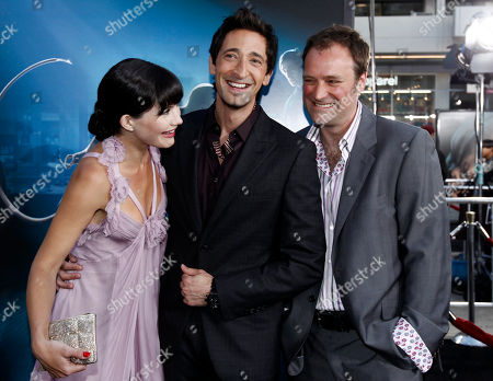 """Delphine Chaneac, Adrien Brody, David Hewlett Cast members Delphine Chaneac, left, Adrien Brody, center, and David Hewlett pose together at the premiere of """"Splice"""" in Los Angeles on"""