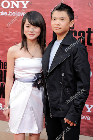 "Stock Photo of Wenwen Han, Zhenwei Wang Wenwen Han, left, and Zhenwei Wang pose together at the premiere of the film ""The Karate Kid"" in Los Angeles"