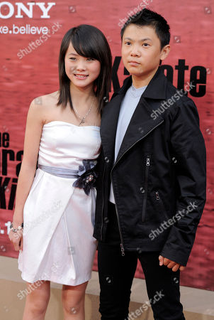 "Stock Picture of Wenwen Han, Zhenwei Wang Wenwen Han, left, and Zhenwei Wang, cast members in ""The Karate Kid,"" pose together at the premiere of the film in Los Angeles"