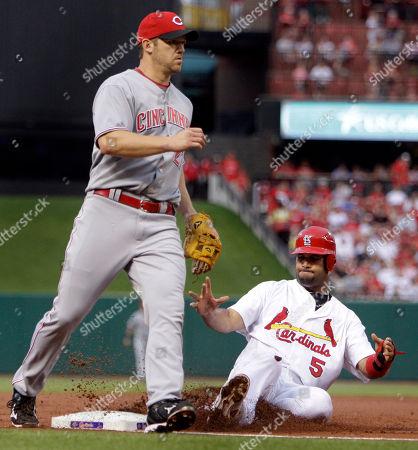 Albert Pujols, Scott Rolen St. Louis Cardinals' Albert Pujols, right, is safe at third on a double steal as Cincinnati Reds third baseman Scott Rolen covers the bag during the first inning of a baseball game, in St. Louis. Matt Holliday was safe at second
