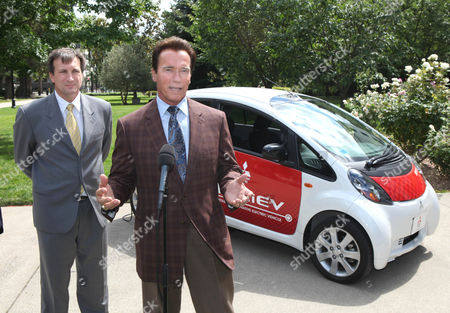 Arnold Schwarzenegger, David Patterson California Gov. Arnold Schwarzengger, right, answers questions after inspecting the 2011 Mitsubishi i-MiEV (Mitsubishi Innovative Electric Vehicle) as Mistubishi Motors of American engineer David Patterson, left, listens at the Capitol in Sacramento, Calif