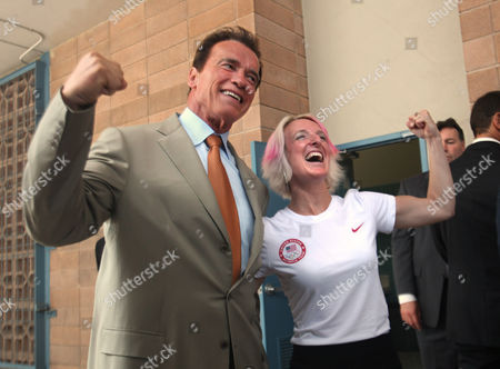 Stock Image of Arnold Schwarzenegger, Shannon Bahrke Gov. Arnold Schwarzenegger flexes his muscles with Olympic Alpine Skier Shannon Bahrke after ceremonies honoring California Olympians and Paralympians at Sutter Middle School in Sacramento, Calif