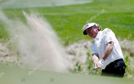 Tommy Armour III Tommy Armour III hits out of a and trap on to the green of the seventh hole during the opening round of the Senior PGA Championship golf tournament in Parker, Colo., on
