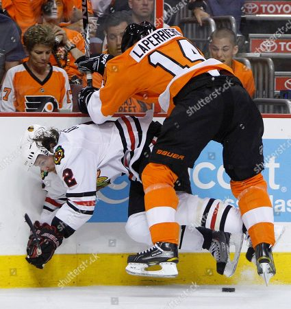 Ian Laperriere, Duncan Keith Philadelphia Flyers center Ian Laperriere (14) checks Chicago Blackhawks defenseman Duncan Keith (2) off the puck in the second period of Game 3 of the NHL Stanley Cup hockey finals, in Philadelphia