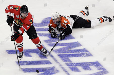 Jordan Hendry, Ian Laperriere Chicago Blackhawks defenseman Jordan Hendry (6) takes the puck away from Philadelphia Flyers center Ian Laperriere (14) in the second period of Game 2 of the NHL hockey Stanley Cup finals, in Chicago