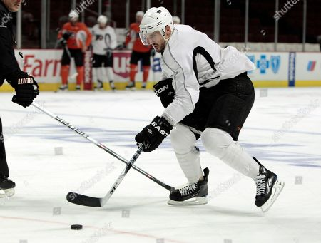 Philadelphia Flyers center Ian Laperriere practices, in Chicago. The Chicago Blackhawks are scheduled to play the Flyers in Game 2 on Monday