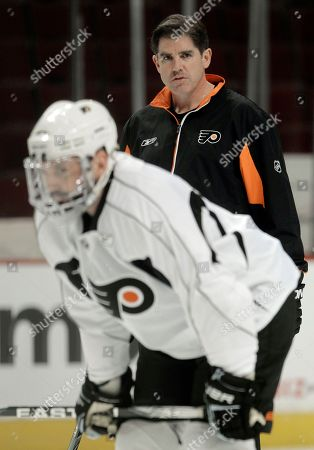 Peter Laviolette, Ian Laperriere Philadelphia Flyers head coach Peter Laviolette supervises a practice, in Chicago. At left is center Ian Laperriere. Laviolette won't say who is starting in goal for Game 2 of the Stanley Cup hockey finals against the Chicago Blackhawks on Monday. The Blackhawks lead the series 1-0