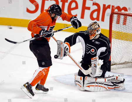 Ian Laperriere, Brian Boucher Philadelphia Flyers center Ian Laperriere, left, gets out of the way of a shot as goalie Brian Boucher (33) makes a stop during hockey practice, in Philadelphia. The Flyers beat the Chicago Blackhawks 4-3 in overtime in Game 3 of the NHL Stanley Cup hockey finals on Wednesday. Game 4 is scheduled to be played Friday with the Blackhawks leading the series 2-1