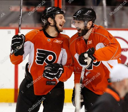 Daniel Carcillo, Ian Laperriere Philadelphia Flyers left wing Daniel Carcillo, left, and center Ian Laperriere, right, joke during a workout, in Philadelphia. The Flyers beat the Chicago Blackhawks 4-3 in overtime in Game 3 of the NHL Stanley Cup hockey finals Wednesday. Game 4 is scheduled to be played Friday with the Blackhawks leading the series 2-1