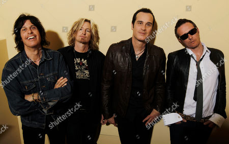 Dean Deleo, Eric Kretz, Robert Deleo, Scott Weiland The Stone Temple Pilots, from left, Dean Deleo, Eric Kretz, Robert Deleo, and Scott Weiland from the band Stone Temple Pilots, pose for a portrait in Santa Monica, Calif. Stone Temple Pilots have accused the band's former frontman Weiland of hijacking its name and songs to promote his solo career. The lawsuit filed, in Los Angeles accuses Weiland of being chronically late to concerts and interfering with the release of a new single by the group