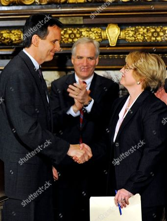 Lorie Skjerven Gildea, Tim Pawlenty, Frank J. Magill Jr Gov. Tim Pawlenty, left, shakes hands with Minnesota Supreme Court Justice Lorie Skjerven Gildea during a news conference where he announced her appointment as Chief Justice of the court in St. Paul, Minn.In center is Frank J. Magill Jr. whom Pawlenty appointed as a district court judge in Hennepin County