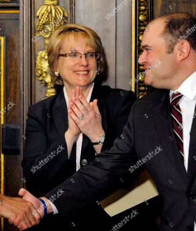 David Stras, Lorie Skjerven Gildea New Minnesota Supreme Court Chief Justice Lorie Skjerven Gildea applauds her replacement on the court, Associate Justice David Stras during a news conference by Gov. Tim Pawlenty in St. Paul, Minn