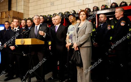 Michael Bloomberg, Salvatore Cassano New York City Mayor Michael Bloomberg, center, is joined by Fire Commissioner Salvatore Cassano, Street vendor Lance Orton, New York City Council Speaker Christine Quinn and the fire fighters from Engine Co. 54, Ladder Co. 4 and Battalion 9, during a news conference, in New York's Times Square