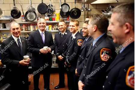 Michael Bloomberg, Salvatore Cassano New York City Mayor Michael Bloomberg, and Fire Commissioner Salvatore Cassano, second from left, with firefighters from Engine Co. 54, Ladder Co. 4 and Battalion 9 who responded to Saturdays incident in Times Square, in New York