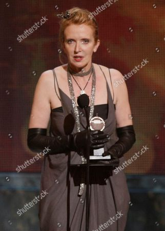 """Catherine Zuber Catherine Zuber accepts the Tony Award for Best Costume Design of a Play for her work on """"The Royal Family"""" during the 61st Tony Awards, in New York"""