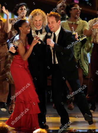 """Montego Glover, David Bryan, Chad Kimball Montego Glover, left, David Bryan, center, and Chad Kimball celebrate after the play """"Memphis"""" won the award for Best Musical during the 61st annual Tony Awards in New York"""