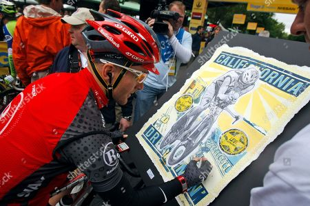 Levi Leipheimer Levi Leipheimer signs a poster with his likeness during stage 2 of the Tour of California cycling race in, Davis, Calif