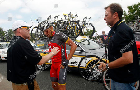 Lance Armstrong Cyclist Lance Armstrong, center, chats with team manager Johan Bruyneel, right, and an unidentified team official, left, after crashing during the fifth stage of the Tour of California cycling race in the outskirts of Visalia, Calif