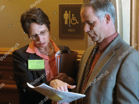 Kansas Transportation Secretary Deb Miller, left, discusses a proposal for a new highway program with Sen. Tim Huelskamp, a Fowler Republican, outside the Senate chamber at the Statehouse in Topeka, Kan