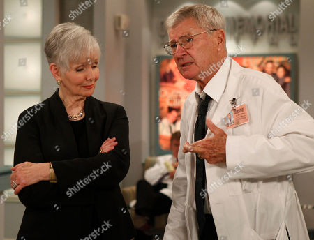 """Stock Picture of Kathryn Hays, Don Hastings In this June 15, 2010 photo, Kathryn Hays, left, watches colleague Don Hastings cross his fingers during taping an episode of the long-running soap opera """"As the World Turns,"""" at JC Studios in New York, . The final episode of the soap opera, which has been running since 1956, will air on Sept. 17"""