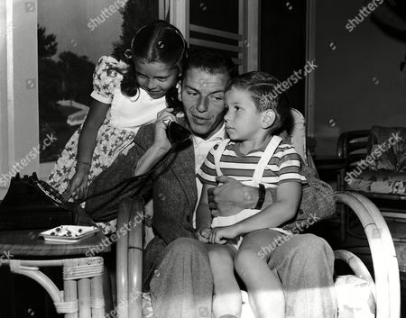 American singer and actor Frank Sinatra with daughter Nancy and son Frank Junior in Hollywood, California in 1948. (Exact date unknown