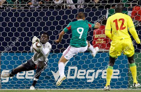 Khadim Ndiaye, Javier Hernandez Senegal goalie Khadim Ndiaye, left, saves a shot of Mexico's Javier Hernandez during the first half of the international friendly soccer match in Chicago