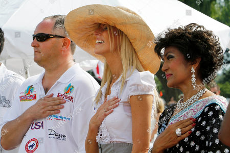 Tareq Salahi, Michaele Salahi, Nilima Mehra Tareq Salahi, Michaele Salahi, and Nilima Mehra, hold their hands over their hearts during the U.S. national anthem, at the start of America's Polo Cup Championships, which the Salahi's hosted, by the National Mall in Washington, on