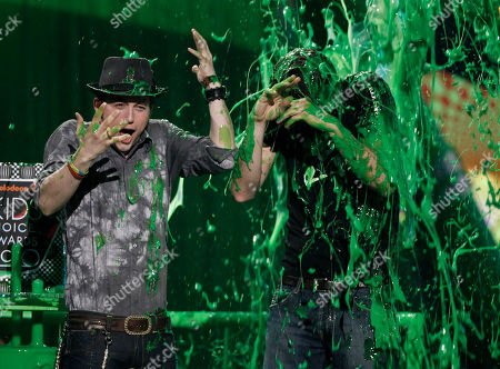 Jackson Rathbone, Jerry Trainor Jackson Rathbone, left, and Jerry Trainor get slimed at Nickelodeon's 23rd Annual Kids' Choice Awards, in Los Angeles