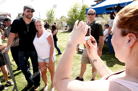 James Otto Musician James Otto, left, poses for a photo with a fan after performing at the Academy of Country Music Lifting Lives USO show for U.S. Air Force service members and their families at Nellis Air Force Base in Las Vegas, on