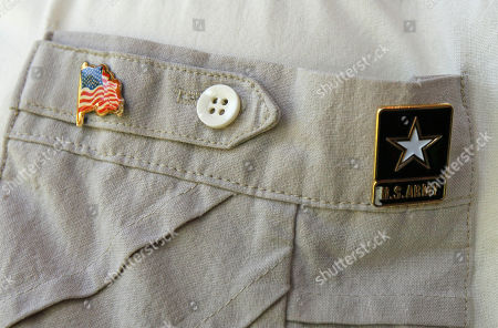 Retired U.S. Army Sgt. Major Chris North, a Vietnam and Korean war veteran, wears his Army pin in Fayetteville, N.C. Tony Chavonne, the mayor of one of America's most renowned Army cities wants to establish cultural ties to a rural Vietnamese town, a plan that has angered some veterans who served there generations ago