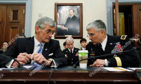 John McHugh, George Casey Secretary of the Army John M. McHugh. left, and Army chief of Staff Gen. George W. Casey, Jr., talk before the start of a House Committee on Appropriations, Subcommittee on Defense, hearing on the posture of the army on Capitol Hill in Washington
