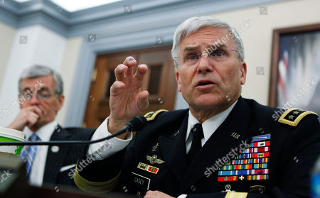 John McHugh, George Casey Army chief of Staff Gen. George W. Casey, Jr., and Secretary of the Army John M. McHugh, left, testify before the House Committee on Appropriations, Subcommittee on Defense, during a hearing on the posture of the army, on Capitol Hill in Washington