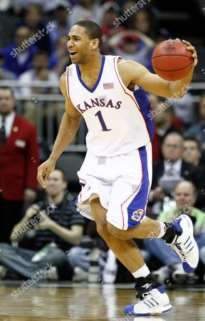 Xavier Henry Kansas guard Xavier Henry dribbles the ball during the second half of an NCAA college basketball championship game against Kansas State at the Big 12 Conference men's tournament, in Kansas City, Mo. Kansas won 72-64