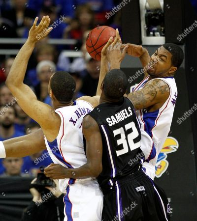 Markieff Morris, Xavier Henry, Jamar Samuels Kansas' Markieff Morris, right, and Xavier Henry, left, battle for a rebound with Kansas State's Jamar Samuels during the second half of an NCAA college basketball championship game at the Big 12 Conference men's tournament, in Kansas City, Mo. Kansas won 72-64