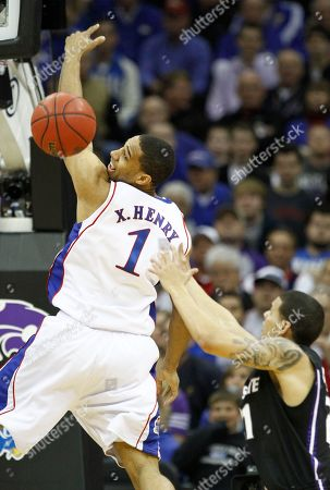 Xavier Henry, Denis Clemente Kansas guard Xavier Henry, left, fights for a rebound with Kansas State guard Denis Clemente during the first half of an NCAA college basketball championship game at the Big 12 Conference men's tournament, in Kansas City, Mo