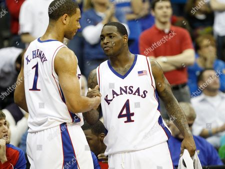 Sherron Collins, Xavier Henry Kansas's Sherron Collins, right, reacts with teammate Xavier Henry during the second half of an NCAA college basketball game against Texas A&M at the Big 12 Conference men's tournament, in Kansas City, Mo. Kansas won 79-66