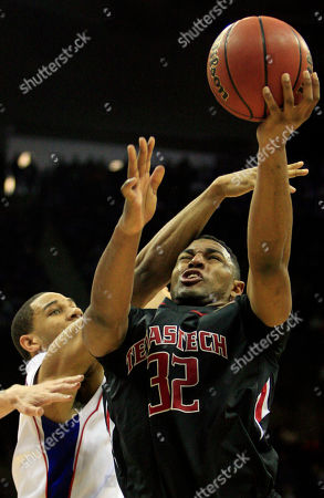 Mike Singletary, Xavier Henry Texas Tech forward Mike Singletary (32) is fouled by Kansas guard Xavier Henry (1) during the second half of an NCAA college basketball game at the Big 12 tournament, in Kansas City, Mo. Kansas defeated Texas Tech 80-68
