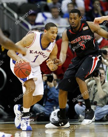 Xavier Henry, D'walyn Roberts Kansas guard Xavier Henry (1) dribbles past Texas Tech forward D'walyn Roberts during the first half of an NCAA college basketball game at the Big 12 Conference men's tournament, in Kansas City, Mo