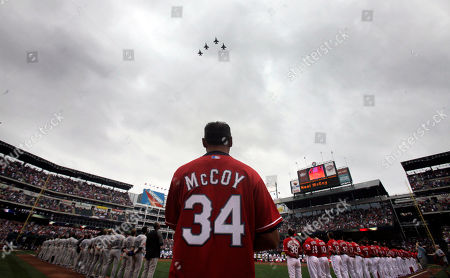 Jets fly overhead as country singer Neal McCoy sings the national anthem before the season opener baseball game between the Toronto Blue Jays and Texas Rangers in Arlington, Texas