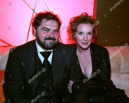 Julio Macat and wife Elizabeth Perkins