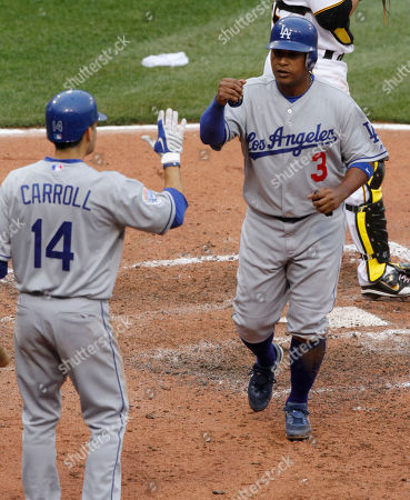 Ronnie Belliard Los Angeles Dodgers' Ronnie Belliard, right, is greeted by on-deck batter Jamey Carroll after scoring on a hit by Garret Anderson in the seventh inning of the baseball game against the Pittsburgh Pirates in Pittsburgh, . The Dodgers won 10-2