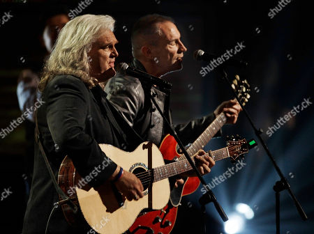 Ricky Skaggs, Gordon Kennedy Ricky Skaggs, left, and Gordon Kennedy perform at the Dove Awards, in Nashville, Tenn. The Dove Awards are given for accomplishment in gospel music